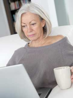 woman-with-cup-and-computer